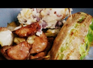 New Year's cabbage rolls, sauteed cabbage with kielbasa and onions, and served with rustic red potato mash